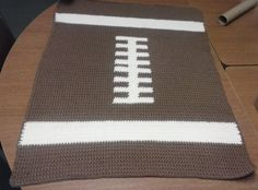 Crochet Baby Football Blanket by ChrisCreatesCrafts on Etsy, $25.00