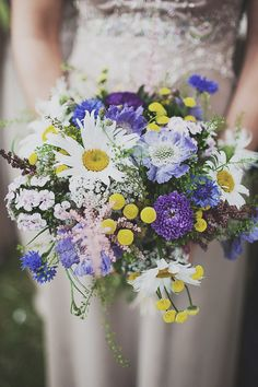 Wild Flower Purple & Yellow Wedding Bouquet  | Outdoor Ceremony | Festival Theme Wedding | Image by Anna Hardy Photography. | http://www.rockmywedding.co.uk/wildflowers-at-wedfest/