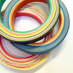 Baum - Study O Portable: Bangles made by layering colored ceramic resin onto a rotation spit.
