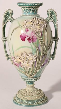 Lovely double handled Nippon vase with pedestal base and floral moriage over hand painted florals.