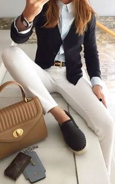 Cream pants, white button up, navy cardigan, and navy bottoms.