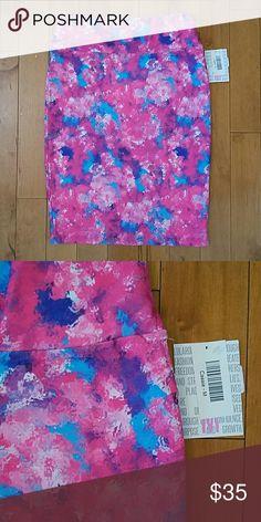 NWT LuLaRoe Cassie Skirt Medium NWT LuLaRoe Cassie Skirt.  Size medium.  Beautiful colors - pinks, blue, purples! LuLaRoe Skirts Pencil