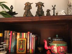 This pic is part of Anuradha Singh's Home Tour at Noida on The Keybunch decor blog - Anuradha's bookshelf is decorated with quirky pieces Old Antiques, Antique Shops, London Map, Madhubani Painting, Blue Pottery, Indian Home Decor, My Furniture, Victoria And Albert Museum, Decorating Blogs