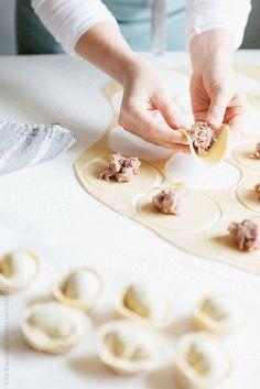 Woman making meat dumplings in the kitchen