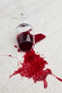 spilling red wine all over your rug;  Use equal parts of hydrogen peroxide and liquid Dawn dish soap to remove the stain. you should never apply it directly to the rug. Instead, apply the mixture to a cotton towel or rag, then blot the area until the stain fades; never, ever rub a wine stain. Use cold water to rinse the soap and water, then let the rug air dry.
