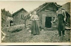 1910 Primitive prairie log cabin, man with blacksmith tools and woman holding a pan.