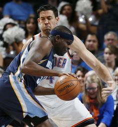 Oklahoma City's Nick Collison (4) defends Memphis' Zach Randolph (50) during an NBA basketball game between the Oklahoma City Thunder and the Memphis Grizzlies at Chesapeake Energy Arena in Oklahoma City, Friday, Feb. 3, 2017. Photo by Nate Billings, The Oklahoman