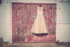 Wedding dress hanging on barn - Image by JNP