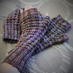 This pattern is for a longish mitt for DK yarn that goes about halfway up the arm in a Waffle Weave pattern. To use less yarn or to get a shorter mitt, I suggest halving the ribbing and wrist section (before the gusset).