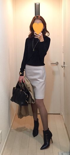 Black knit: Drawer, Light grey skirt: Ballsey, Bag: Tod's, Boots: Jimmy Choo