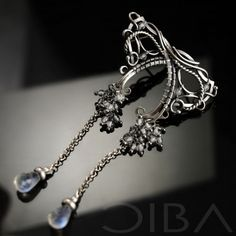 Florence  A pair of delicate sterling silver, wire-wrapping earrings with beautiful moonstone drops.