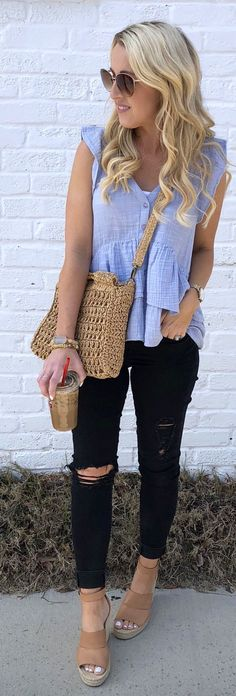#spring #outfits woman with brown knitted bag near white wall during daytime. Pic by @twopeasinablog