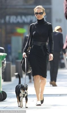 Black turtleneck dress with a large leather accent belt