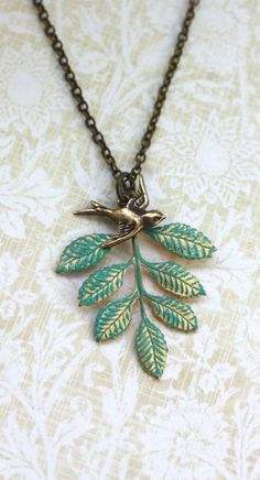 Gold brass leaf + bird necklace :: love!