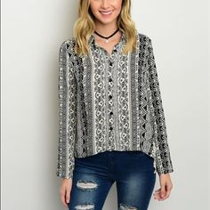 Gorgeous black/white boho crochet detail blouse! Button up blouse- hi lo style with a pretty boho black and white print with cream crochet sides- obsessed! Tops Blouses