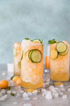 These Cucumber Melon Gin Spritzers are the most refreshing summer cocktail! They're made with a cantaloupe simple syrup, fresh mint, sliced cucumber, gin of course, and a splash of soda water! #cocktail #gin #summercocktail