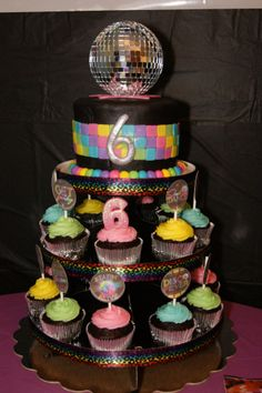 Just Dance (Disco) Party Cake/Cupcake Tower; vanilla cake with vanilla buttercream covered with chocolate marshmallow fondant.  Cupcakes; chocolate cake with vanilla buttercream.