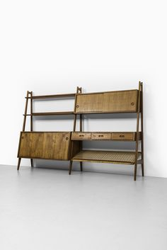 Arne Vodder & Anton Borg; Teak and Cane Bookcase for Vamo, 1950s.
