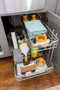 Is that cabinet under your sink a scary messy you've been ignoring? Learn helpful tips on how to organize under the kitchen sink and maintain it with ease. Under sink sliding organizer Under Kitchen Sink Organization, Under Kitchen Sinks, Bathroom Cabinet Organization, Under Sink Storage, Sink Organizer, Bathroom Storage, New Kitchen, Home Organization, Kitchen Decor