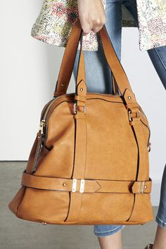 Roomy camel bowler bag with detailed hardware