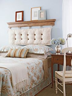 For a new take on an upholstered headboard, hang a bench cushion by its ties from wall-mounted hooks. Top the hooks with a piece of over-door molding, which you can find at a home centre. To create a tufted look, sew covered buttons to the cushion with ribbon, poking both ends through the bottom of the cushion. Pull the ends tight and tie.    Such an easy and awesome idea!