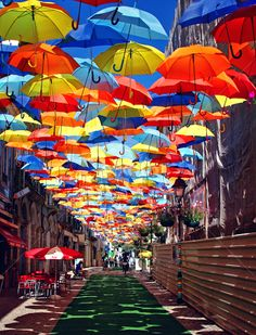 Colorful Umbrellas Float Above the Streets of ‪#‎Agueda‬, ‪#‎Portugal‬
