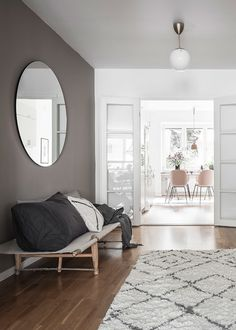 Trendy round mirror and daybed. Scandinavian decoration, interior ideas and inspiration.
