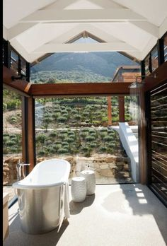 Glass walled bathroom # allows outdoors in