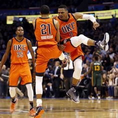 Oklahoma City's Andre Roberson (21) and Russell Westbrook (0) celebrate near Kevin Durant (35) after a basket by Roberson during an NBA basketball game between the Oklahoma City Thunder and the Utah Jazz at Chesapeake Energy Arena in Oklahoma City, Sunday, Dec. 13, 2015. Oklahoma City won 104-98 in overtime. Photo by Nate Billings, The Oklahoman