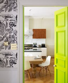 citron door and wallpaper.  fun idea to paint a door a color that you don't want to commit to putting on your whole wall. Fun pop of color.
