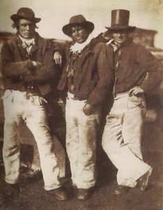 Newhaven, ca. 1845. Alexander Rutherford, William Ramsay and John Liston, three self-confident fishermen in a relaxed pose in front of one of the boats. // Hill and Adamson's calotype