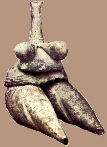 Fired clay figurine about 2.5 inches high. Made about 7000 BC. from Tepe Sarab a prehistoric village site in Western Iran.