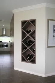 165929567494786083 Wine rack built between wall studs. I dont drink enough wine for this, but love the way it looks.