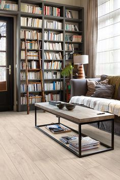 Quick-Step Laminate Flooring - Classic 'Havanna oak natural' (CLM1655) in a classic living room. To find more living room inspiration, visit our website: https://www.quick-step.co.uk/en-gb/room-types/choose-the-perfect-living-room-flooring #salon #woonkamer