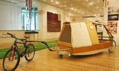 A micro houseboat that you can tow with your bike