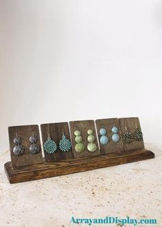 We create jewelry displays using locally sourced, new and reclaimed solid wood in our workshop behind our 1910 Texas farmhouse.  This is our earrings display with a 5 cards in a stand.  Use it at home, in your Etsy shop, a craft market or boutique!  Visit our online store for several jewelry display options to suit you.  Handcrafted.  Made in the USA.