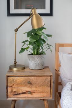 The bedside tables were found at HomeGoods and the bedside lamps came from West Elm.