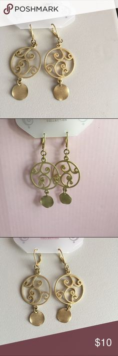 Gold tone earrings Gold tone earrings with circular pattern and disc. Jewelry Earrings