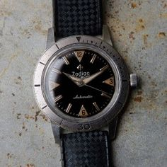 A gorgeous example of an original rare Zodiac Sea Wolf from the 60s. Original features include: All original and untouched glossy dial with radium lume plots, automatic movement with 18,000 bph, 17 jewels, caliber 1624, 34mm case. This handsome vintage watch runs very well, holds a good charge and keeps very good time. This is one to keep in your collection and will only increase in value but do wear it and don't leave … Read More →