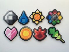Pokemon Perler Bead Sprite Set - Kanto Badges - Tap the pin if you love super heroes too! Cause guess what? you will LOVE these super hero fitness shirts! Pokemon Perler Beads, Diy Perler Beads, Perler Bead Art, Pearler Beads, Hama Beads Patterns, Seed Bead Patterns, Beading Patterns, Pokemon Craft, Pokemon Party