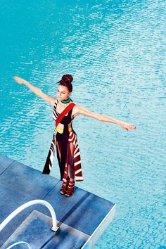 Leading model Barbara Fialho takes a dip in the pool for the January 2016 cover of ELLE Brazil. The brunette babe flaunts her toned figure in a crop top and mini skirt from Osklen on the cover. Photographed by Gustavo Zylbersztajn and styled by Marcell Maia, Barbara looks ready to workout in sporty inspired fashions in the accompanying editorial. Wearing super bright fashions,