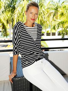 Star Tracks: Monday, April 6, 2015   BEATING THE HEAT   Model Karolína Kurková relaxes in the Lacoste Suite during the Women's Finals at the Miami Open tennis tournament on Saturday.