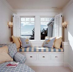 So cozy and what a view!  I want to curl up with a good book here.