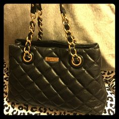 Kate Spade quilted handbag  I'M NOT TOTALLY SET ON SELLING-JUST ENTERTAINING OFFERS    •Beautiful black quilted handbag with gold accents. Gorgeous bag! kate spade Bags
