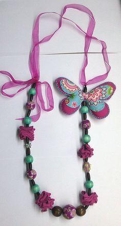 Colar com borboleta by Jóias da Rita, via Flickr