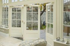 love the idea of having this wall of bi-fold doors that looks farmhouse and not modern
