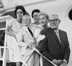 Europe Bound: American cinematic icon Joan Crawford, pictured here with husband (and PepsiCo president) Alfred Steele, his son, and her daughters Cynthia and Cathy, pose for photographers on the First Class Promenade Deck of the United States. This image was taken in 1956: the twin girls would return to America on the disastrous final voyage of the Andrea Doria (Crawford remained in England to commence filming on The Story of Esther Costello).
