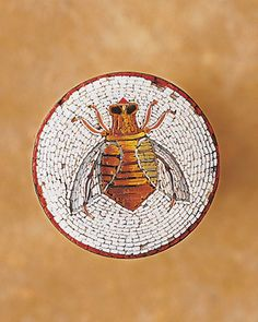 Bee Brooch  An Italian micro-mosaic bee made of tiny filaments of colored glass decorates a Victorian button that has been made into a brooch.