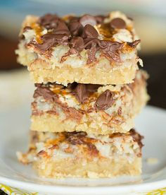 Ultimate Magic Bars - A brown sugar shortbread crust, pecans, coconut, chocolate chips and caramel set in sweetened condensed milk. Easy and delicious! | http://browneyedbaker.com /browneyedbaker/