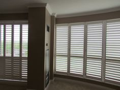 Shades of Home By-Pass Shutters (Patio Door) and framed shutters on living room  Designer: Steve Poxon